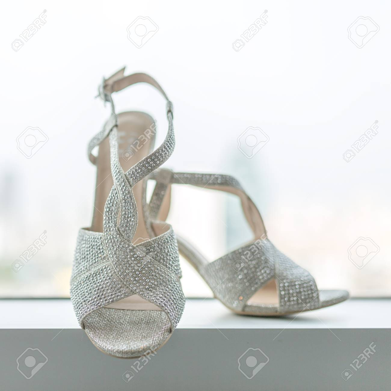 a0a826d4723 Elegant and stylish bridal shoes in a window. - Shallow of focus Stock  Photo -