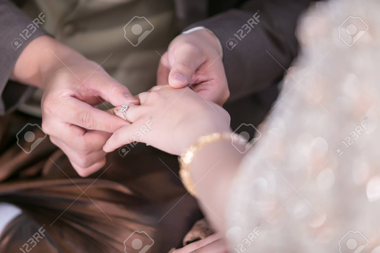Wedding Ceremony. The Bride And Groom Exchange Wedding Rings. Stock ...