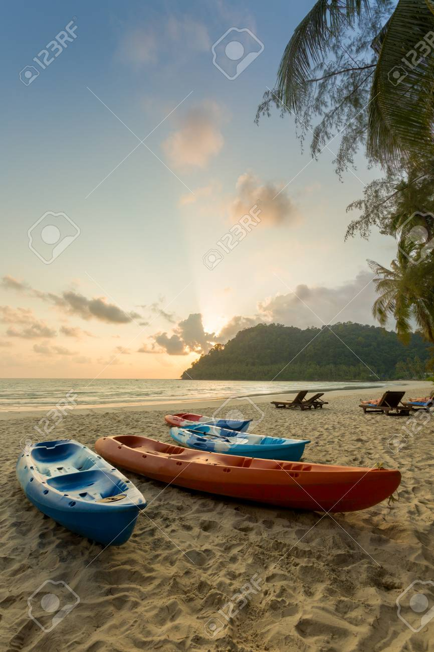 Kayaking boats on the tropical sunset beach background  Travel,