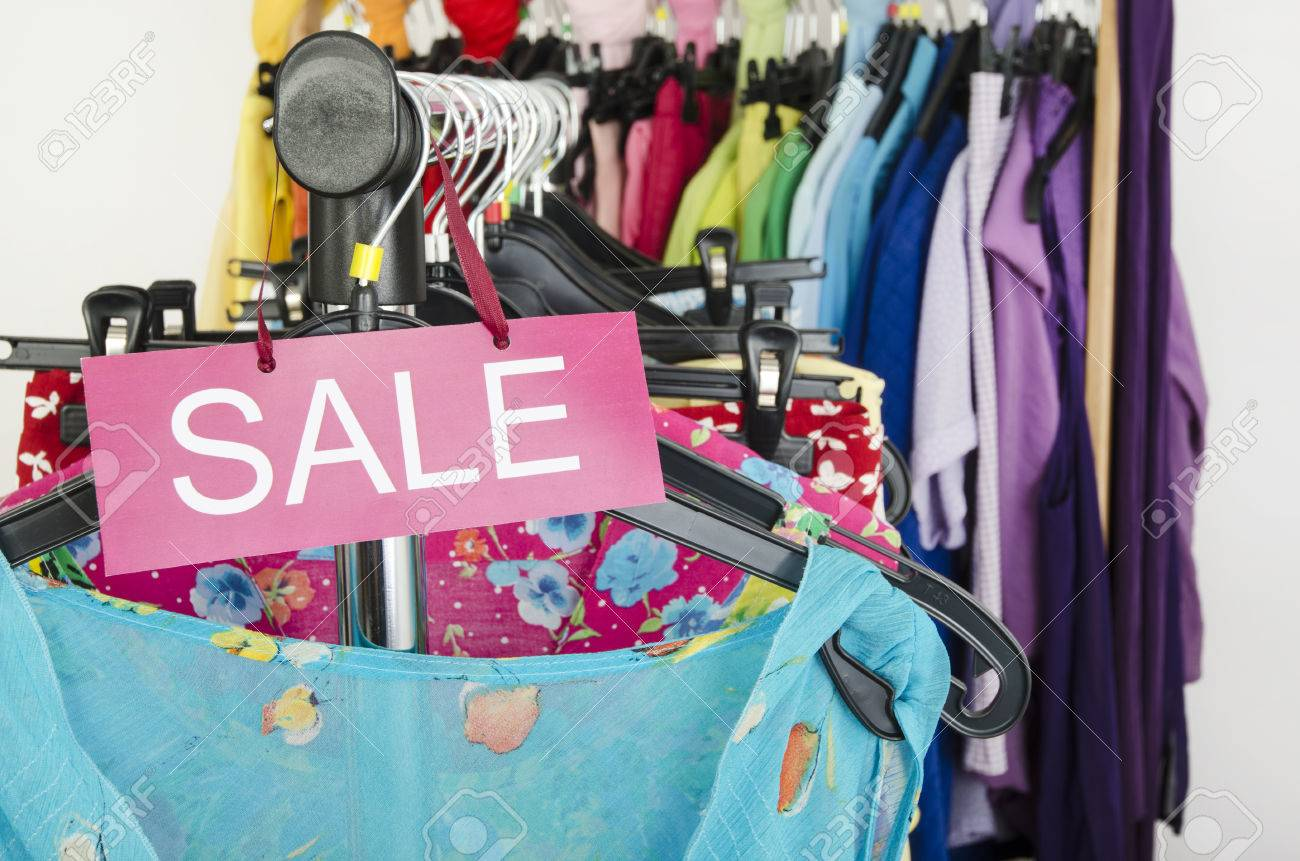 0eeb327d7ba9d Close up on a big sale sign for summer clothes. Clearance rack with colorful  summer