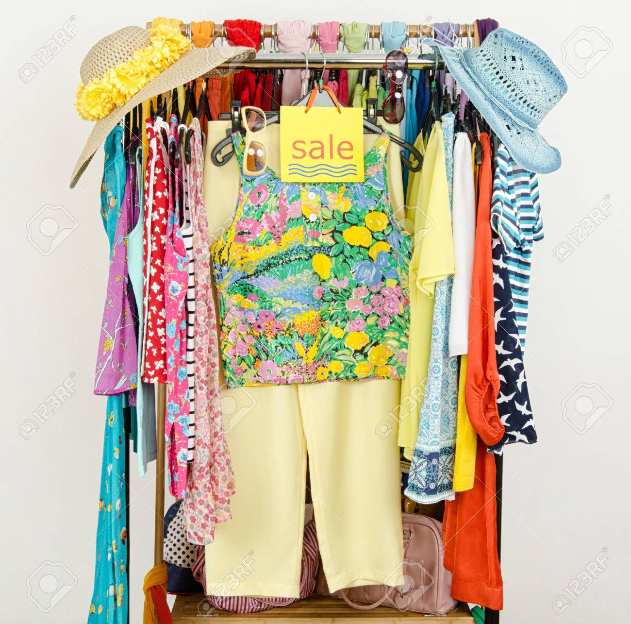 Rack With Summer Clothes And Sale Sign Clearance Rack With ...