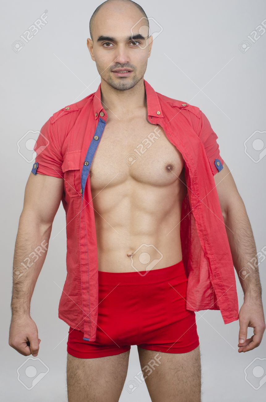 0ce3db2d37 Body of fit muscular man wearing red underwear. Portrait of a handsome bald  man in