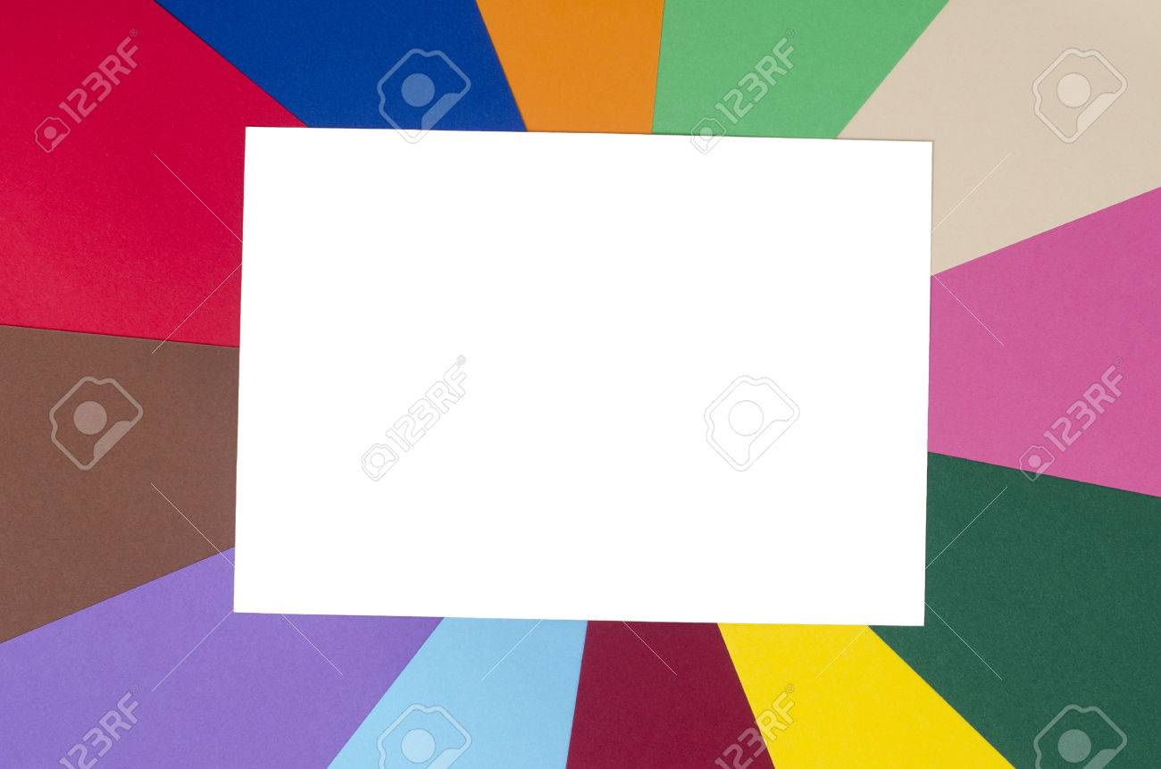 blank white paper on rainbow color paper background stock photo