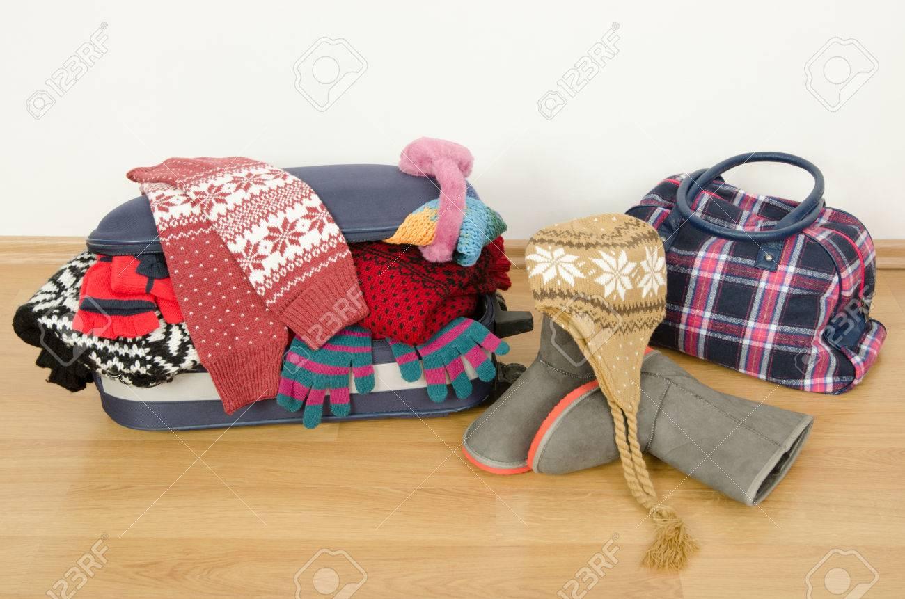 Resultat d'imatges de maleta llena invierno
