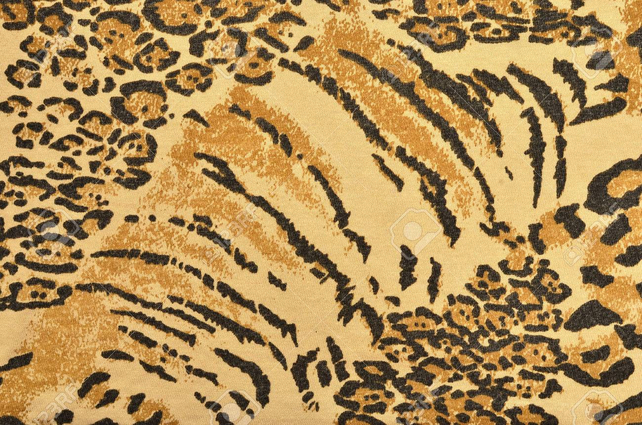 brown and black leopard and tiger fur pattern spotted and striped