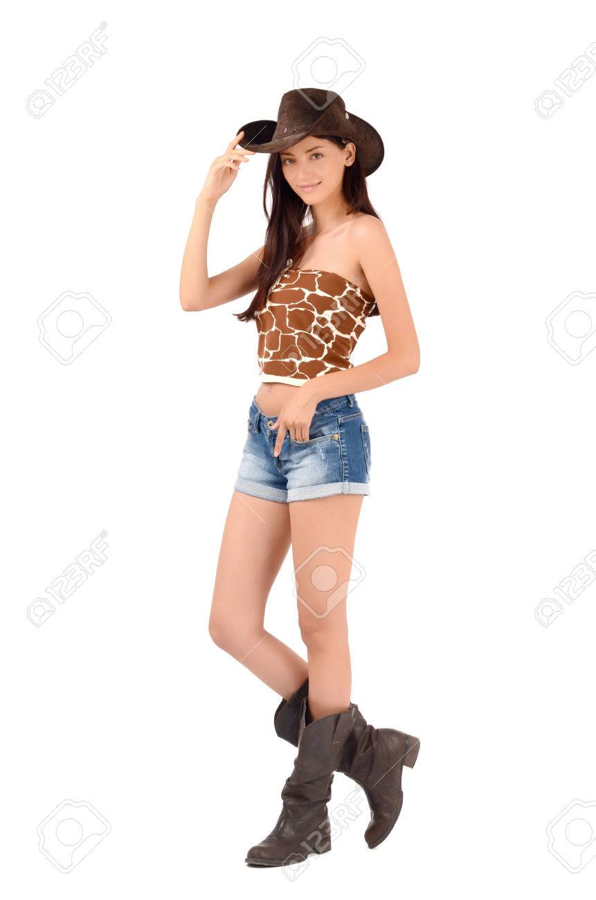Sexy american cowgirl with shorts and boots and a cowboy hat. Isolated on  white background 26ad550f85a
