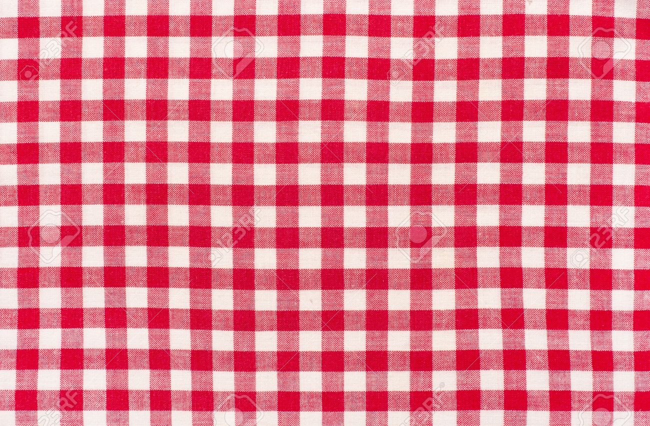 Close Up On Checkered Tablecloth Fabric. Red With White Tartan Square  Pattern As Background.