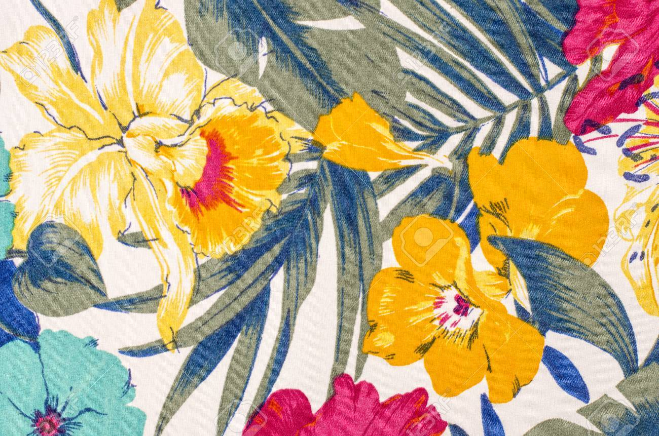 Floral pattern on white fabric colorful exotic yellow flowers colorful exotic yellow flowers with green and blue leaves print mightylinksfo