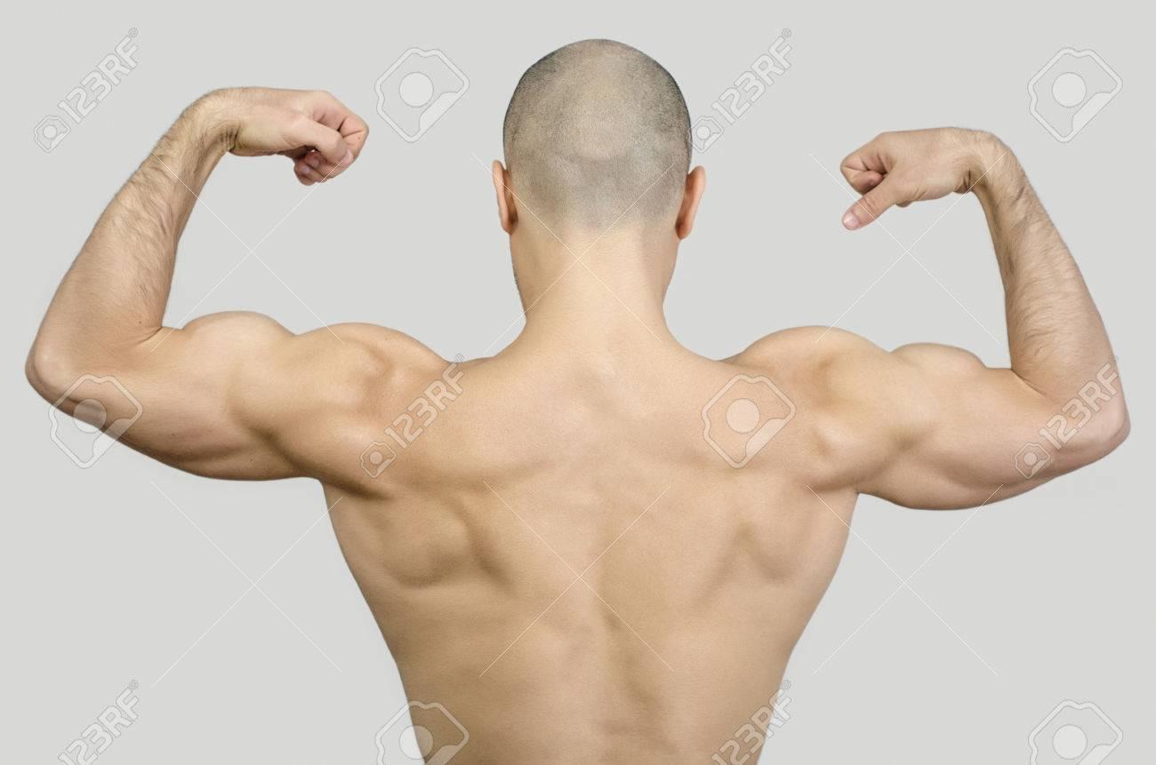 Topless Mann Von Hinten Hob Die Arme Und Fäuste. Fit Bodybuilder ...