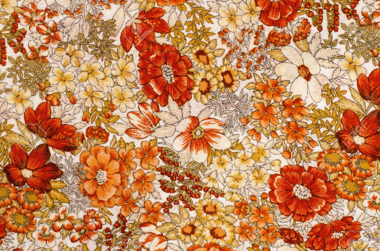 close up on autumn floral pattern on white fabric orange and