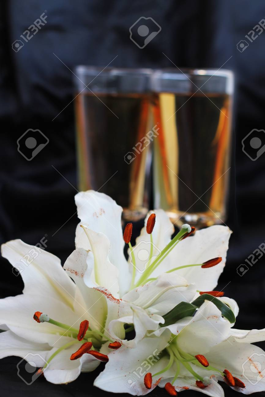 Glasses With Wine And Lily Flower On Black Silk Stock Photo Picture