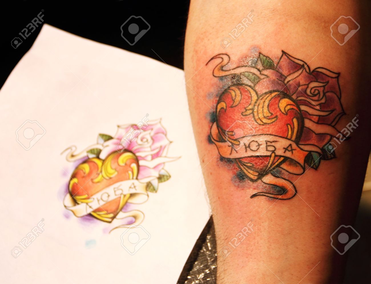 Finished fresh tattoo with sketch on paper Stock Photo - 13489295