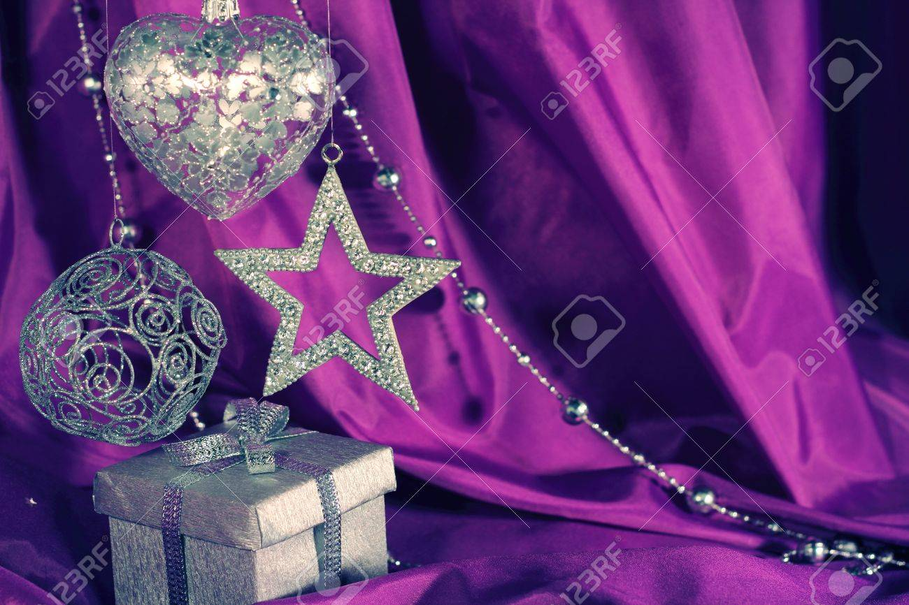 Purple and silver christmas decorations - Silver Christmas Decoration And Gift On Purple Fabric Background Stock Photo 16505712