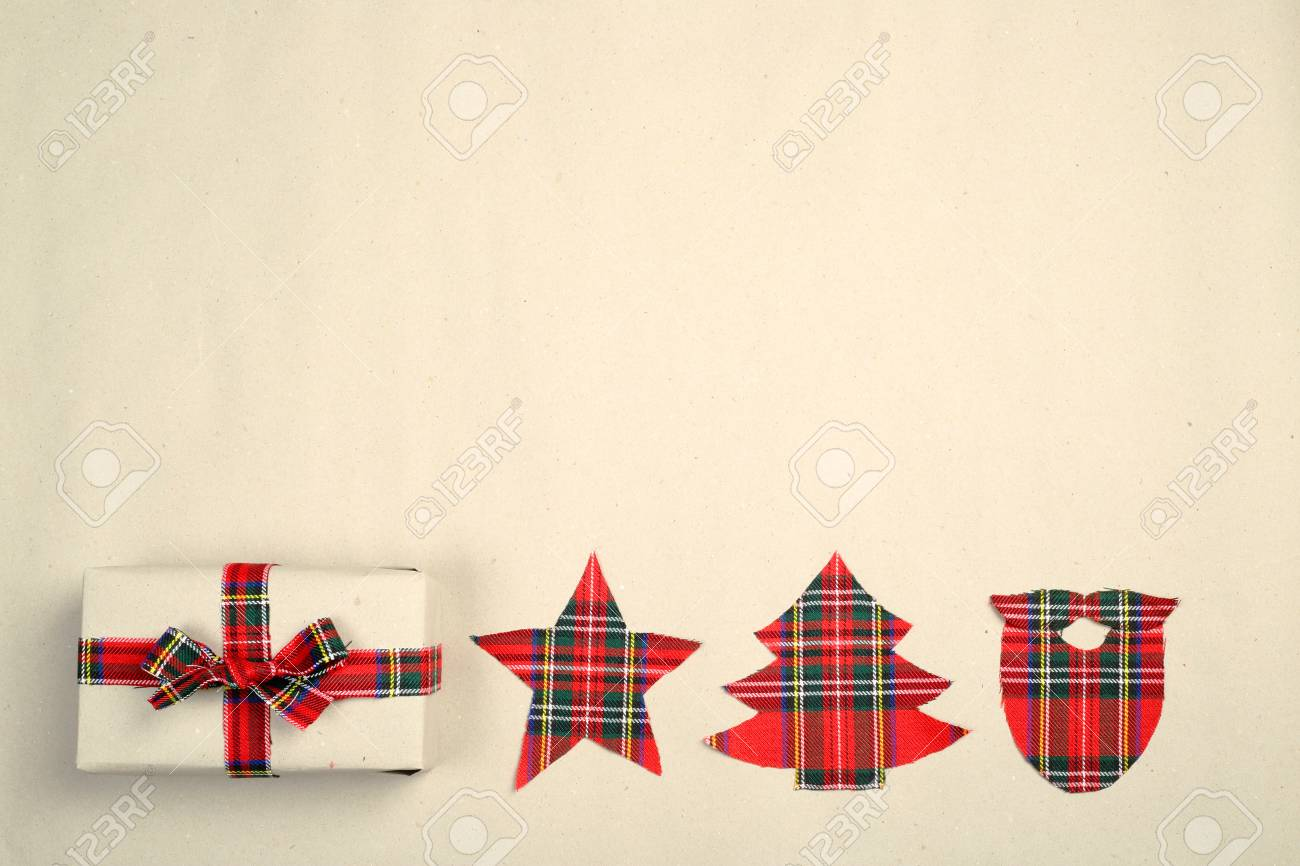 Hipster Christmas Gift Box On Paper Background With Red Cloth Bow And Decor Stock Photo