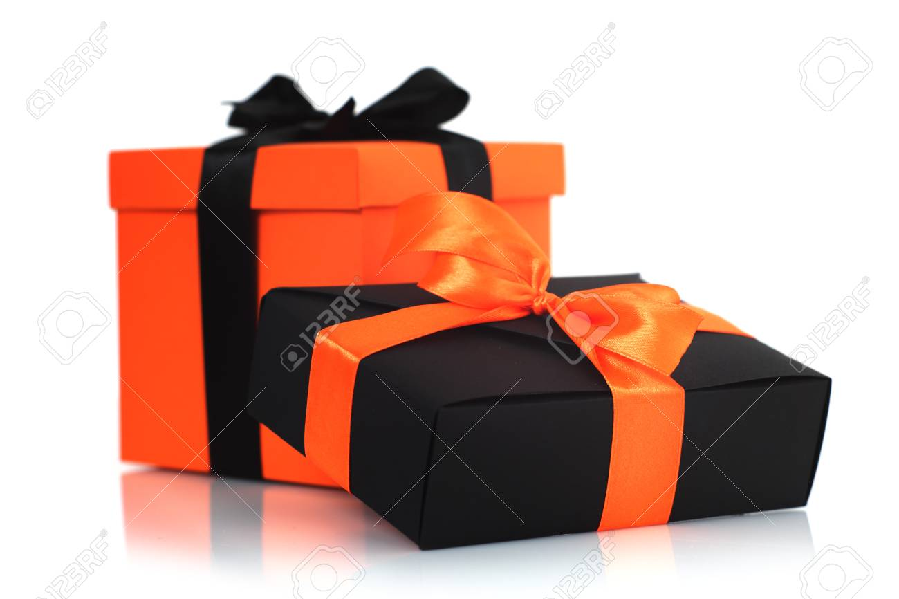 decorated black and orange halloween gift boxes isolated on white