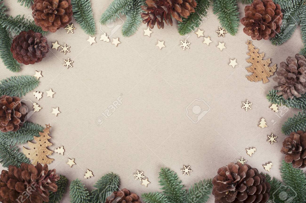 Christmas card light background with wooden decor fir tree branches border frame with copy space - 135585321