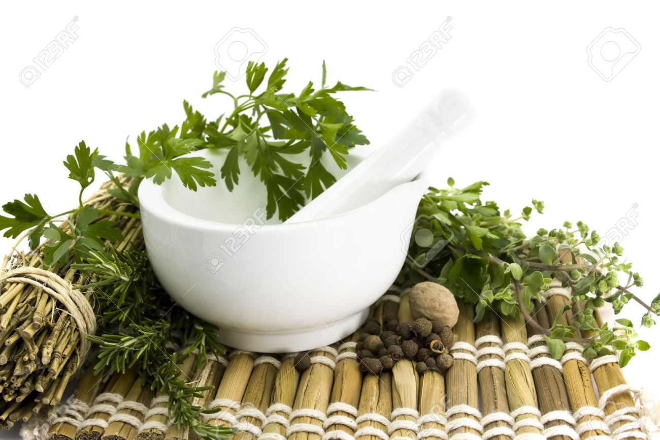 Mortar and pestle with herbs, spices, bamboo mat Stock Photo - 5163613