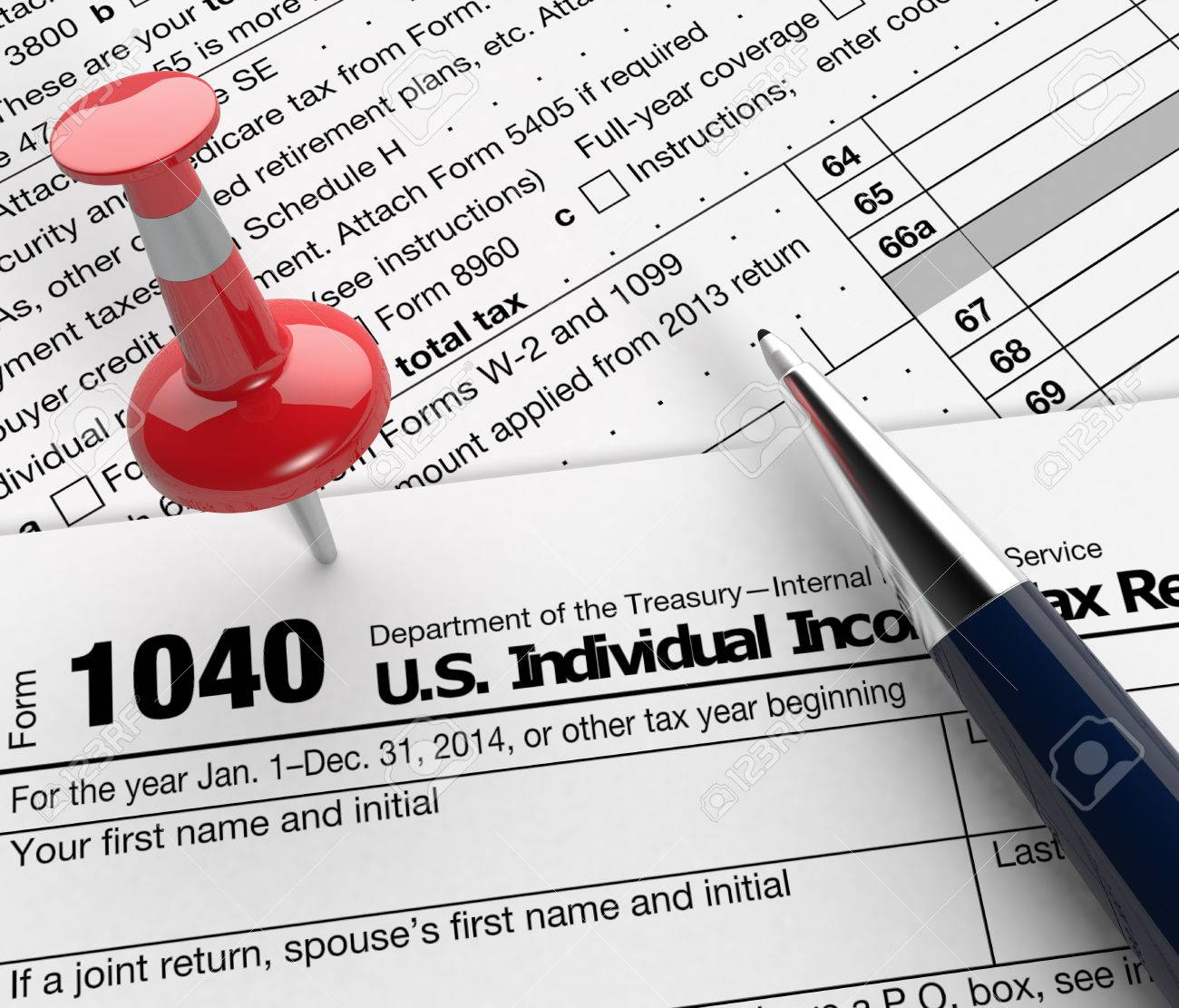 Close Up View Of 1040 Form For Usa Taxes With A Pen And A Red