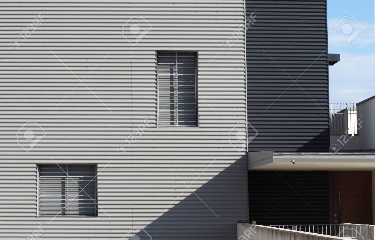 Aluminum cladding on a facade of a new build modern house in minimalist style stock photo