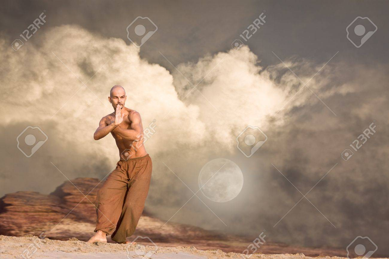 Martial Arts in Front of Rocks and Clouds Background Stock Photo - 9725110
