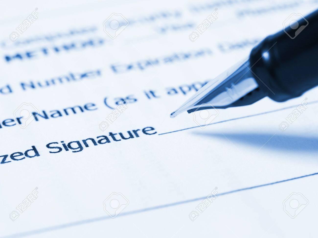 Writing signature (Person writing her signature) Stock Photo - 1201009