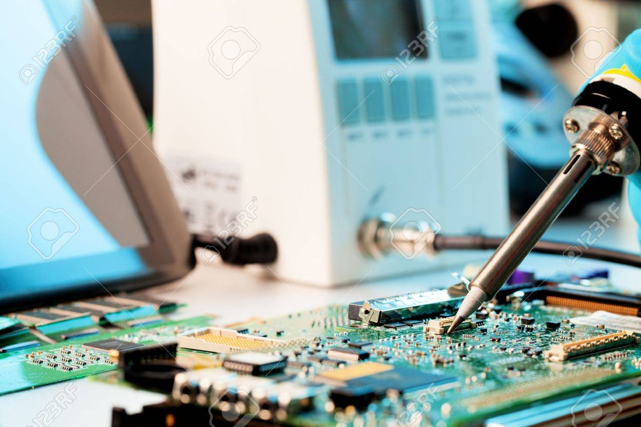 Repaired By Soldering A Pc Board Stock Photo Picture And Royalty Repairing Computer Circuit Free Image 12285555