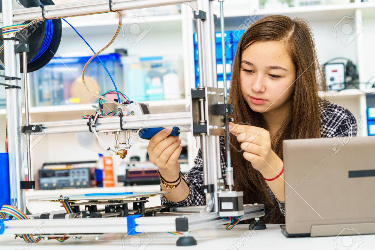 girl in robotics class research electronic device - 66349421