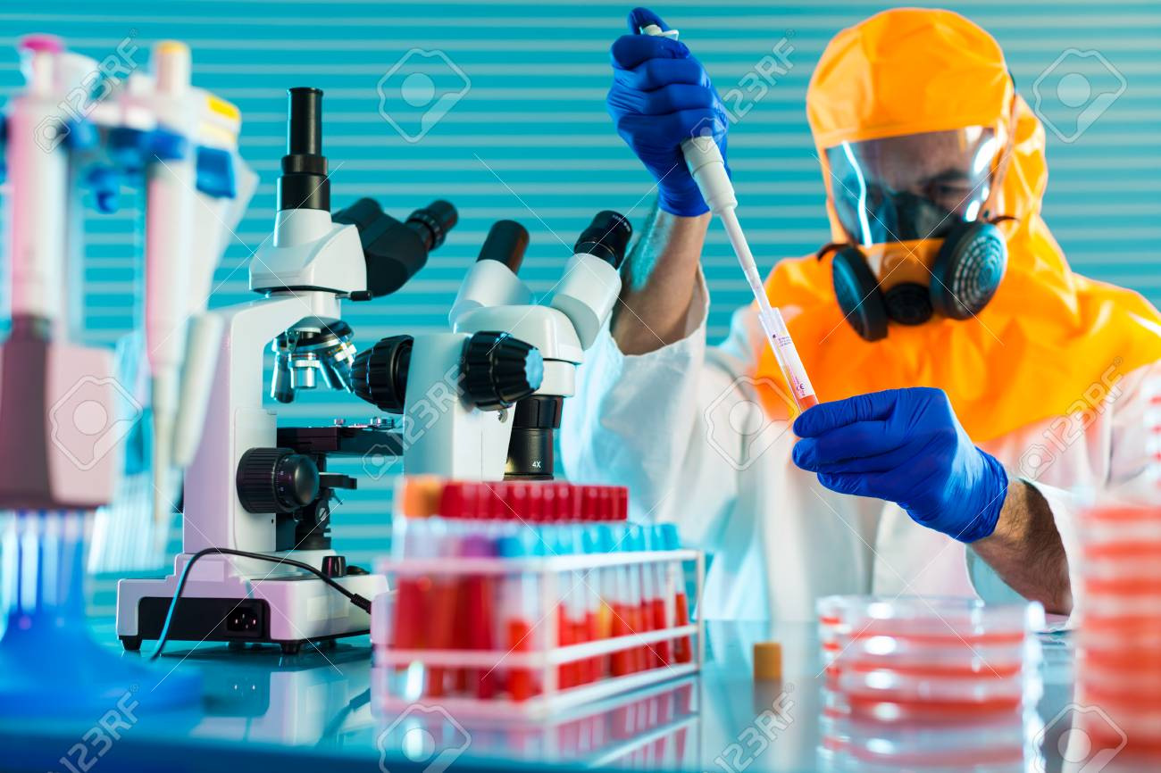 Research Of dangerous viruses in the laboratory. Prevention of a pandemic. A scientist in a biological protective suit works with a pipette - 100198485