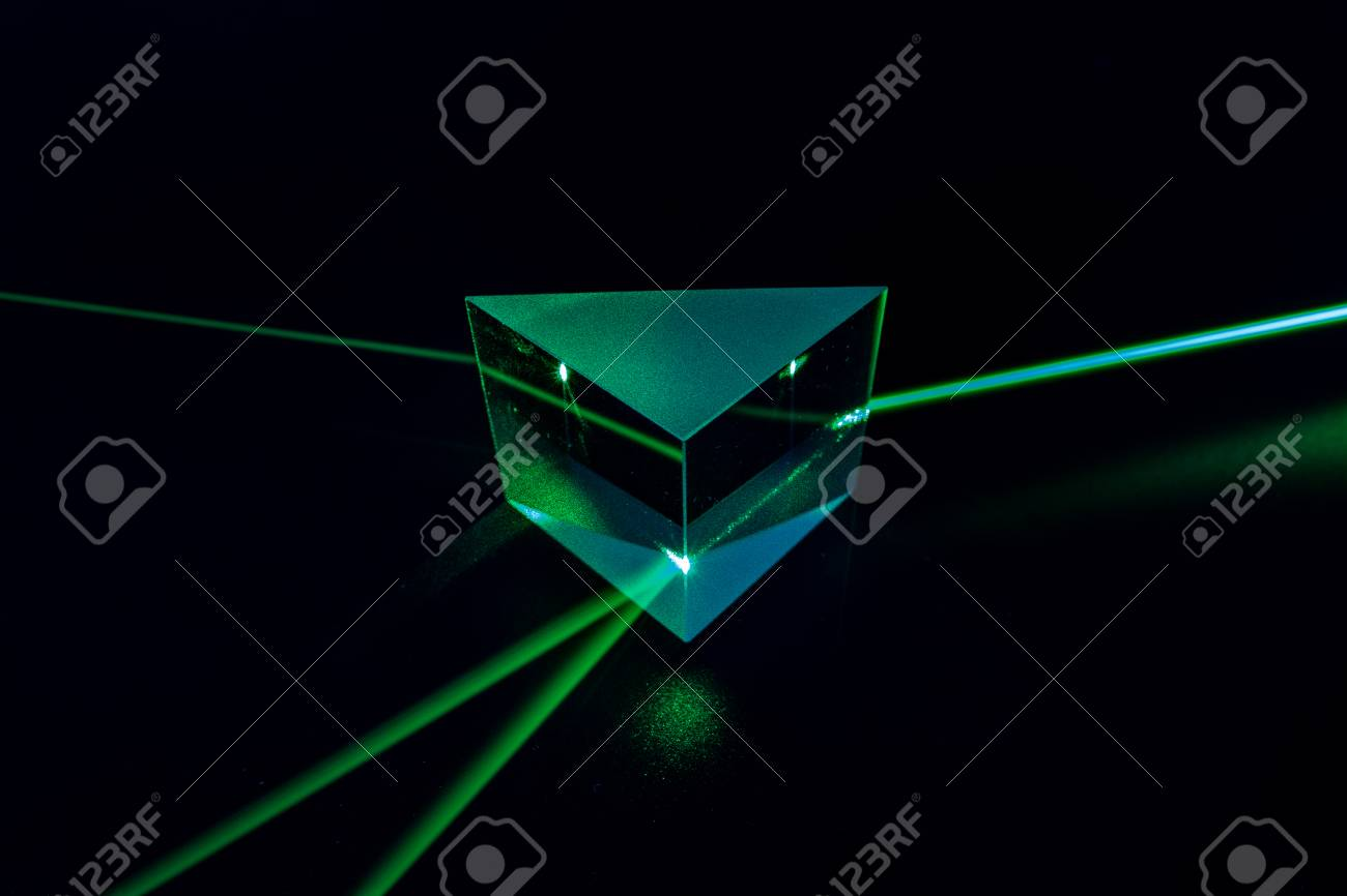 Laser beam and optical glass on black background - 121432043