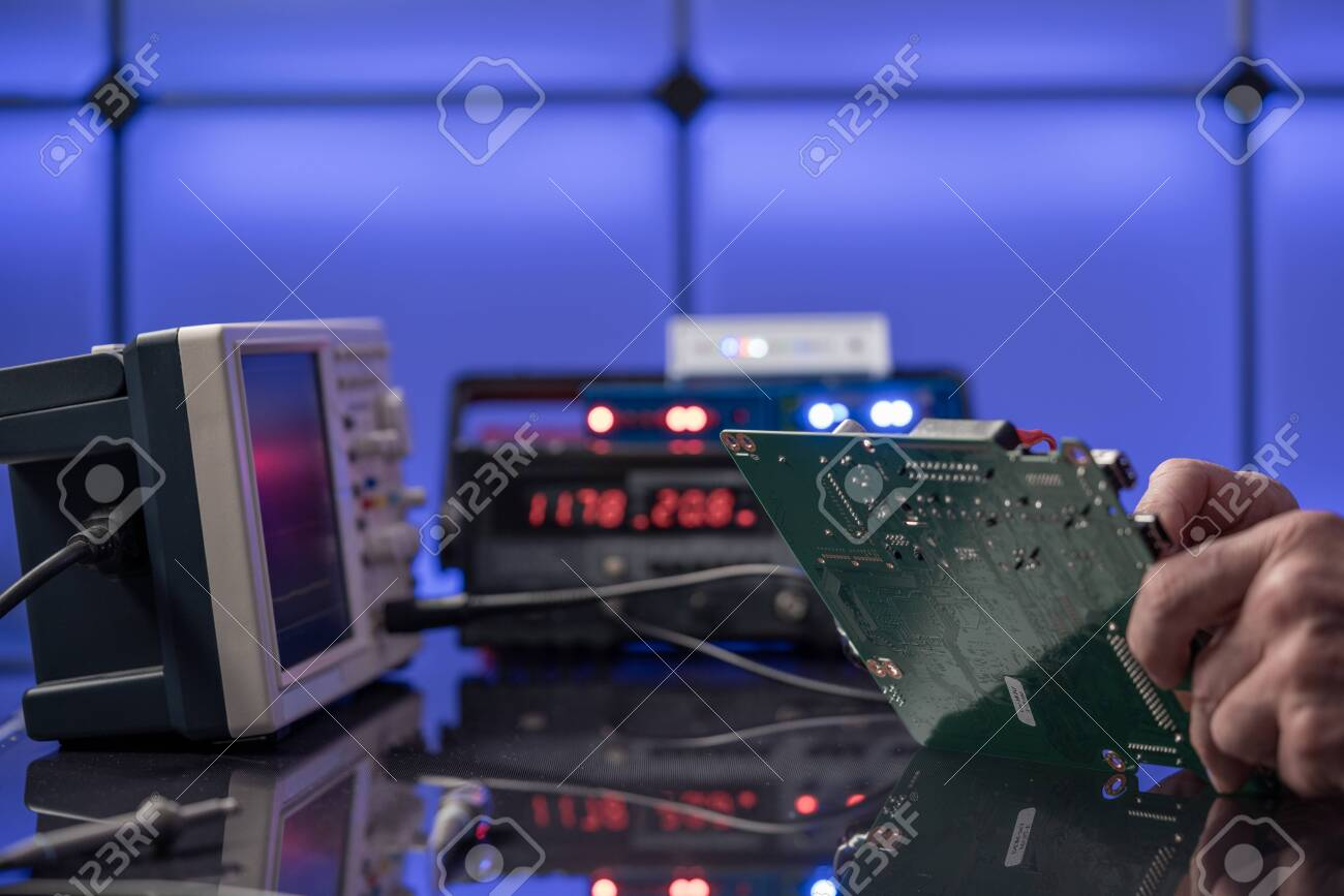 Debugging electronics device. PCB witch microcontroller in electronics laboratory - 144153390