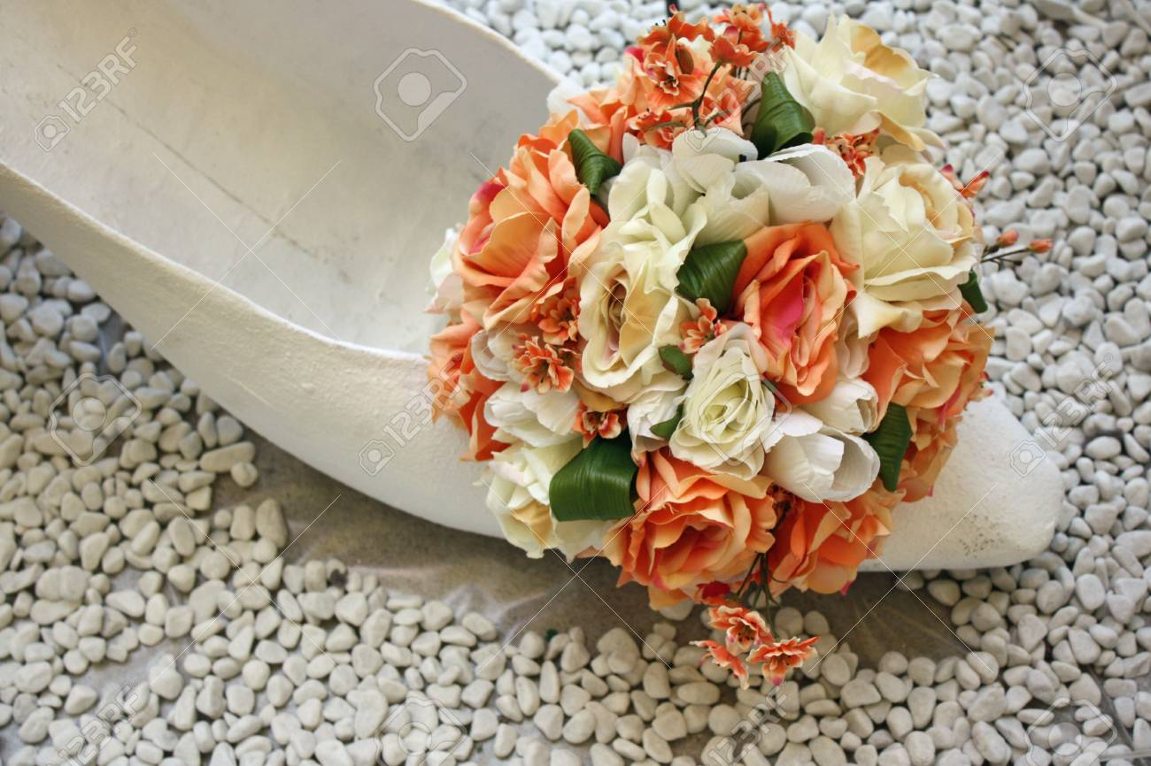 Lady shoe with floral arrangement on top Stock Photo - 4917357