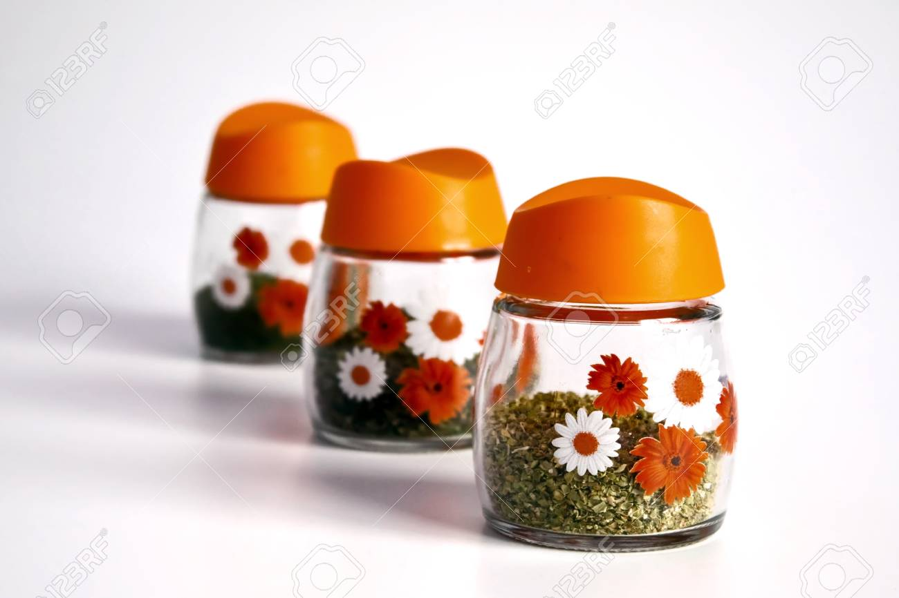 Assortment of spices jars for prepare tasty food with shadow over a white background. Stock Photo - 9673842