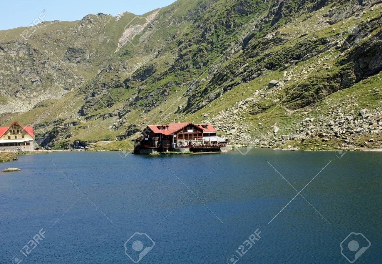 Balea Lake and chalet with the same name, situated on the top of the transfagarasan road Stock Photo - 14540840