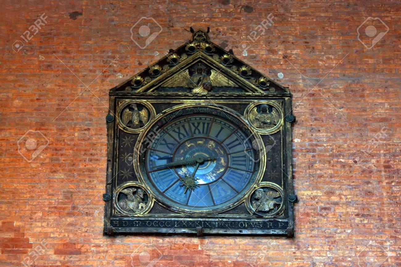 Antique clock on bricks wall from Bologna Stock Photo - 17580235