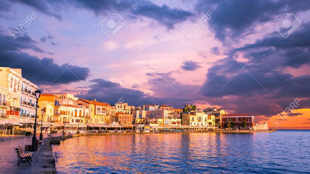 CHANIA, CRETE ISLAND, GREECE - JUNE 26, 2016: Stunning sunset view of the old venetian port of Chania on Crete island, Greece. - 138479122