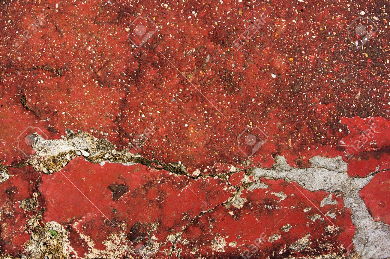 Background of a red cracked worn concrete floor Stock Photo - 13973284