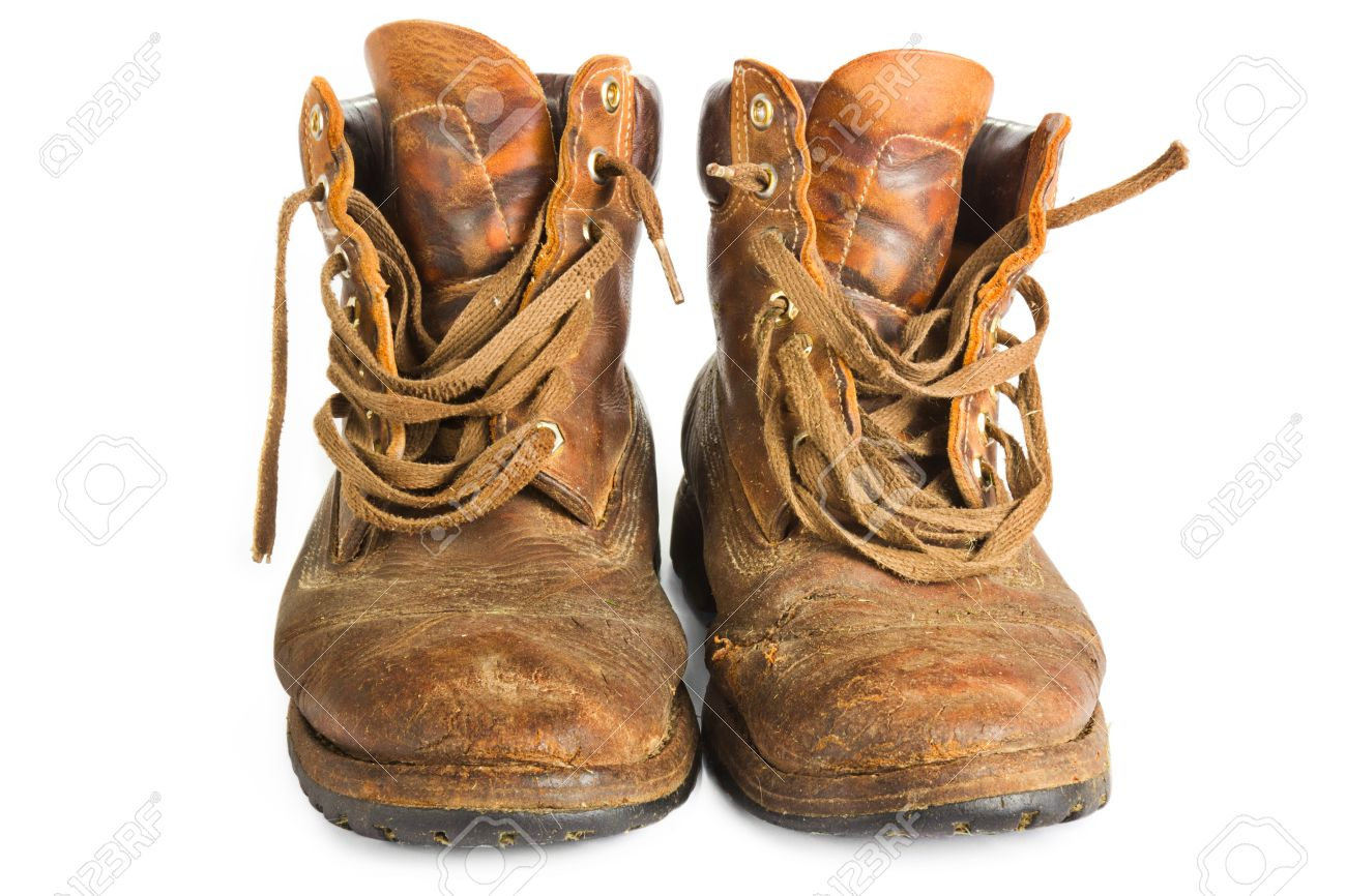 Pair of old worn brown leather work boots on white Stock Photo - 15027461