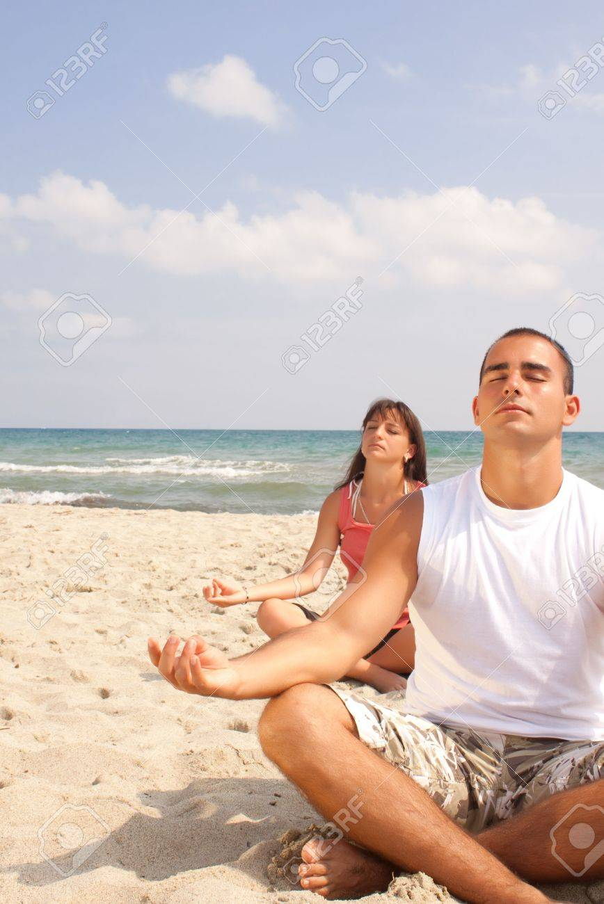 Beach With People Relaxing Two Meditating On The Stock Photo 5977005