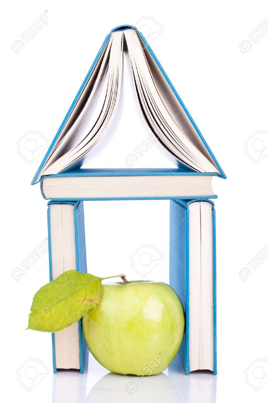 house from three blue books and green apple on white Stock Photo - 6064308