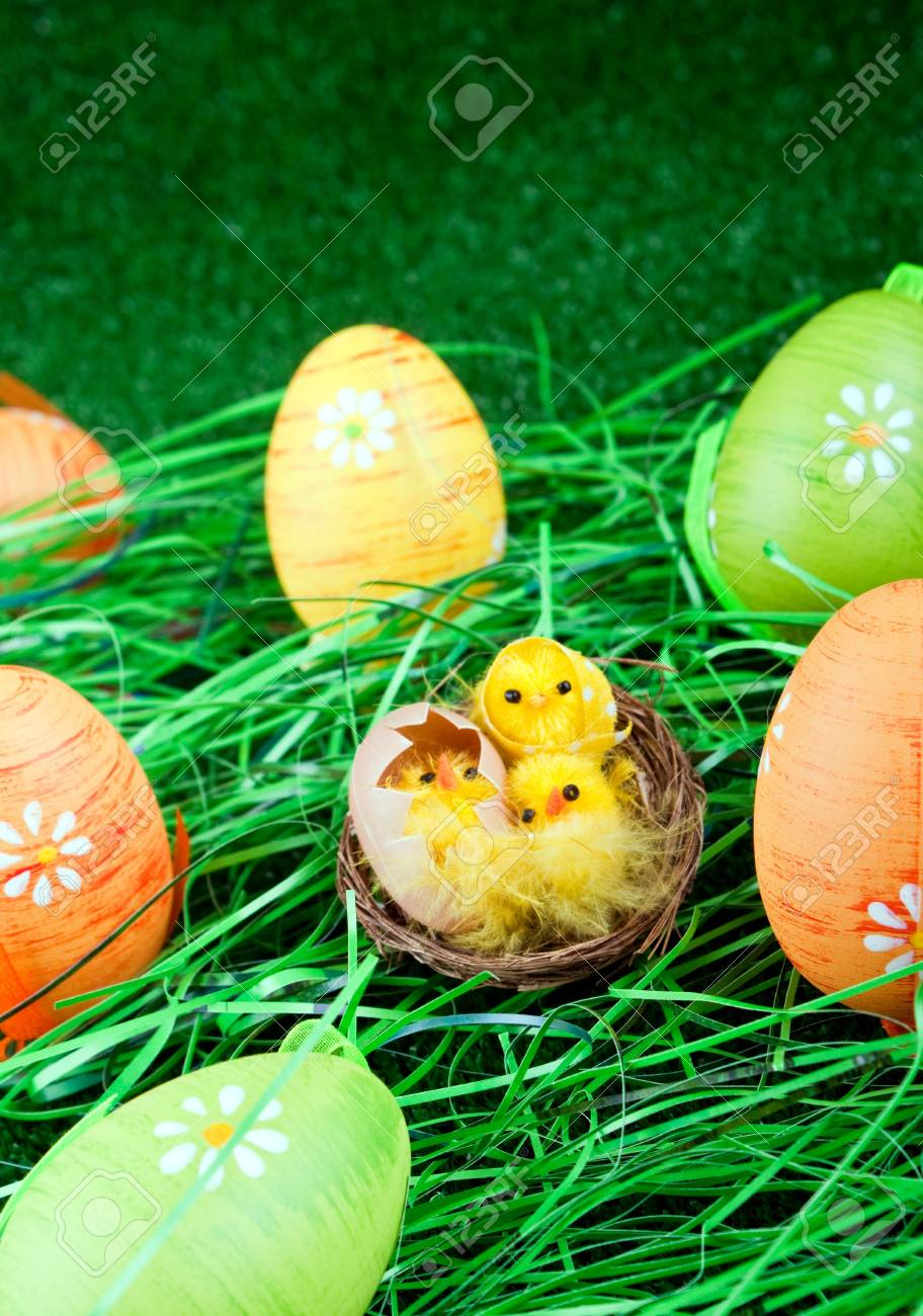 easter eggs and yellow chicken in grass Stock Photo - 6667416