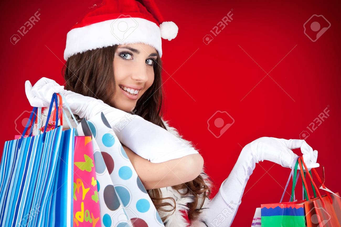portrait of a happy santa woman with shopping bags Stock Photo - 8095763