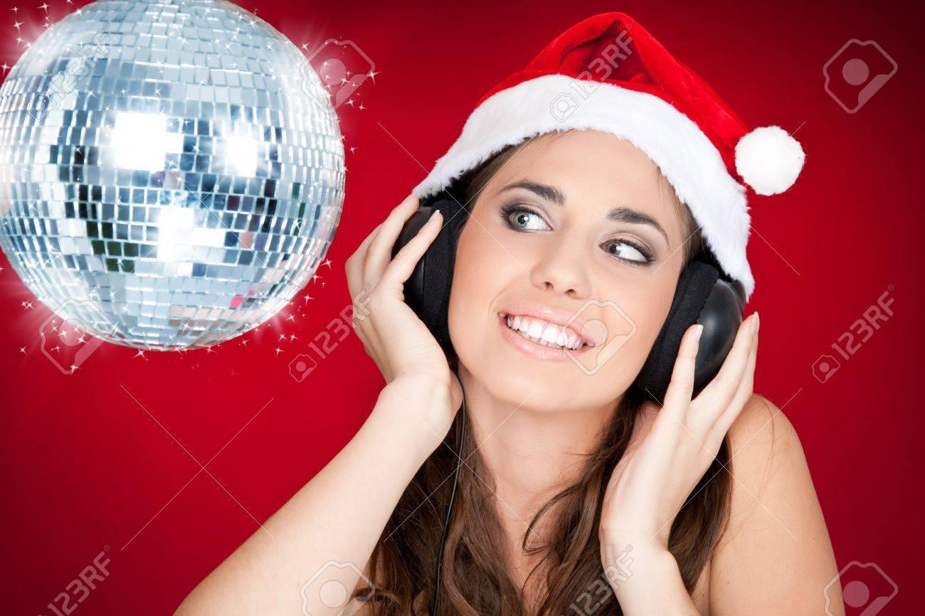 Christmas girl with disco ball listening music Stock Photo - 8095813