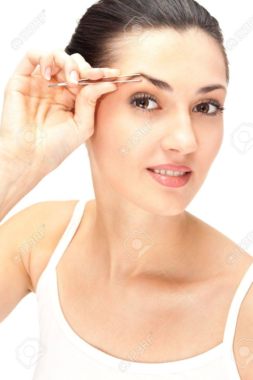 Close Up Woman Looking In Mirror And Plucking Eyebrows Isolated