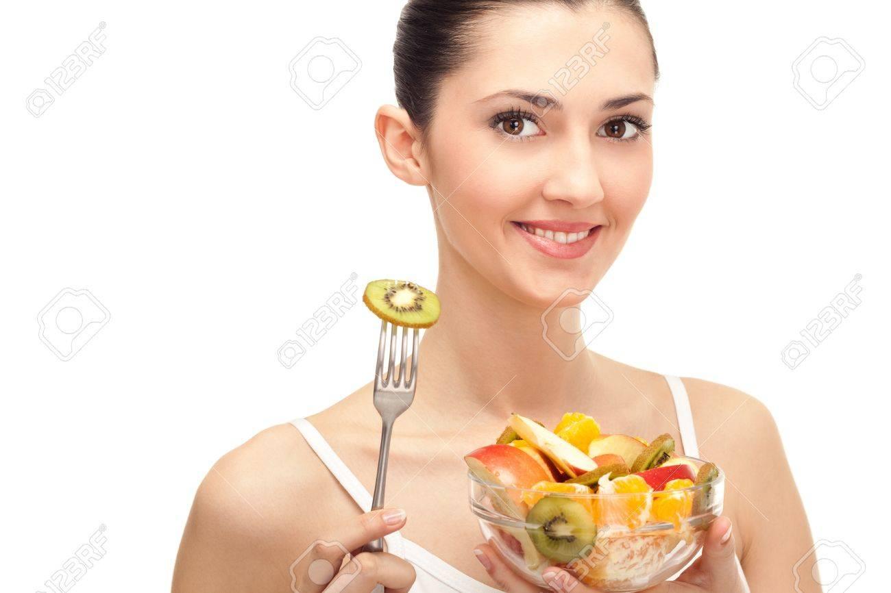 healthy lifestyle, woman holding fruit salad bowl on white background Stock Photo - 9394374