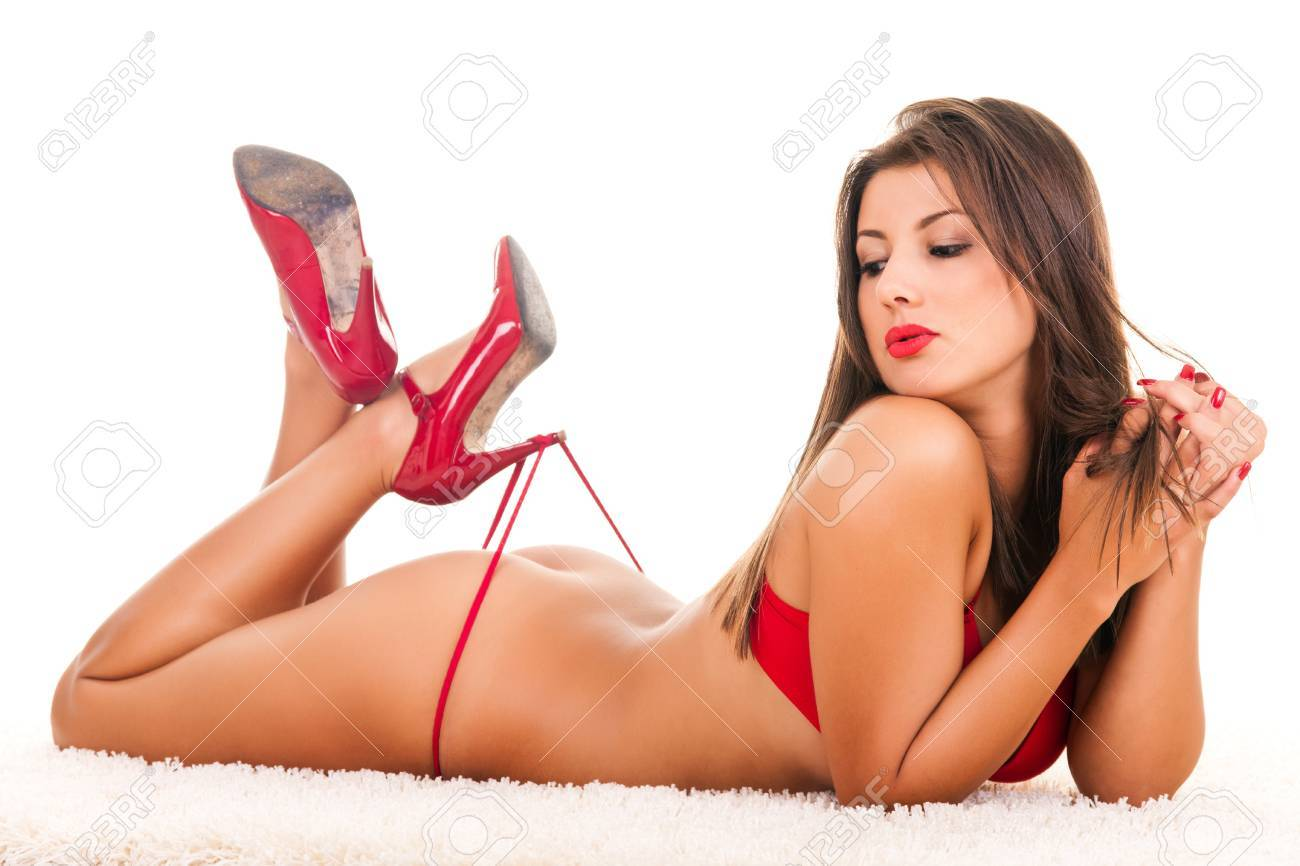 sexy brunette model in red lingerie and high heels Stock Photo - 9394408