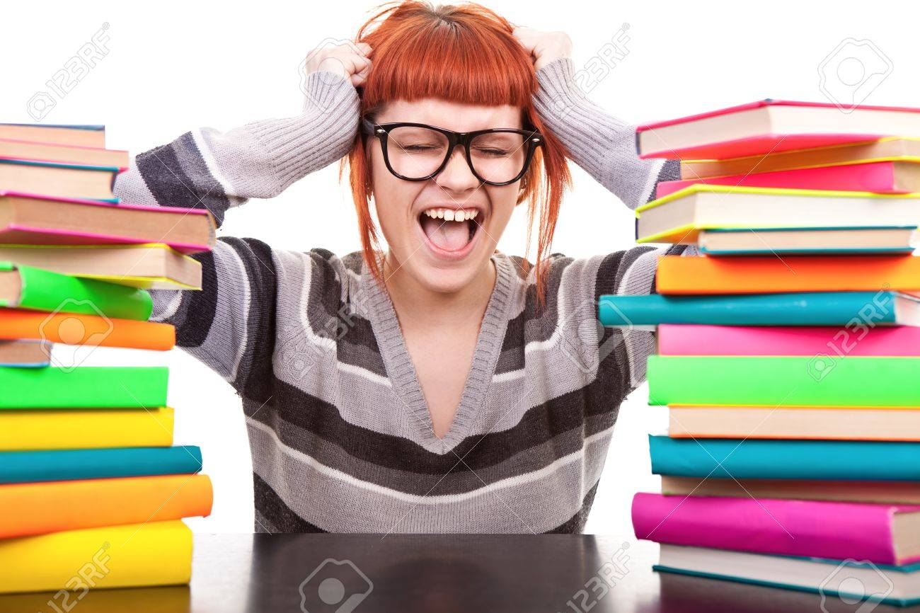 crazy schoolgirl screaming, holding hands up, between, stack of book, isolated on white Stock Photo - 9617134