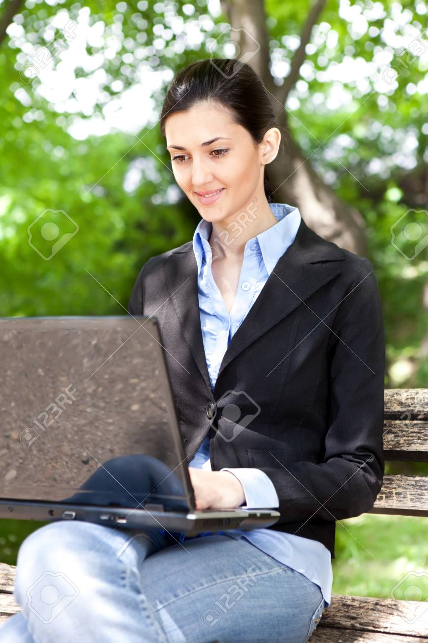 overworked businesswoman working on break in green park Stock Photo - 9617115