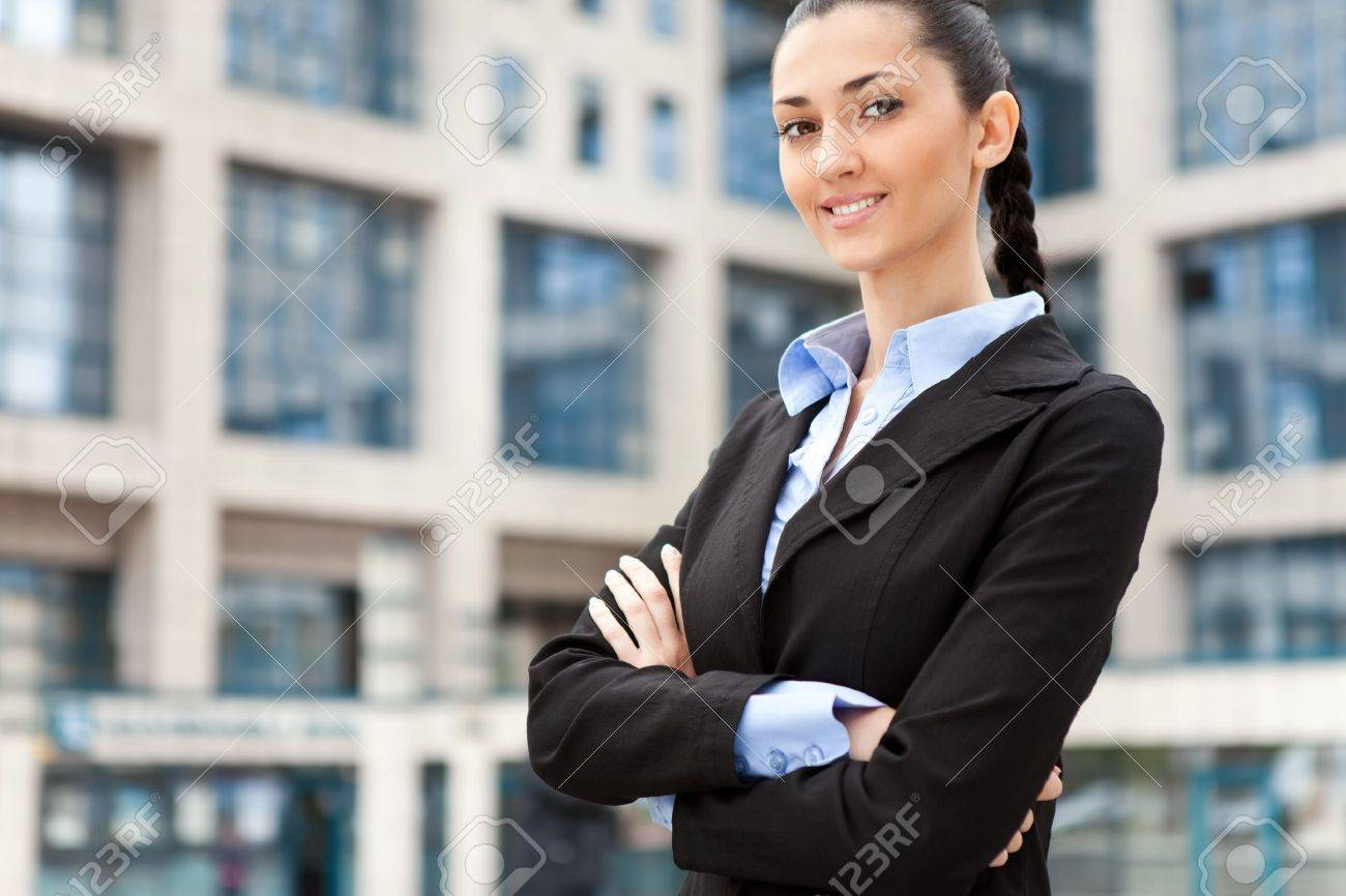 young and attractive businesswoman in suit , image is taken outdoors on a street Stock Photo - 9617129