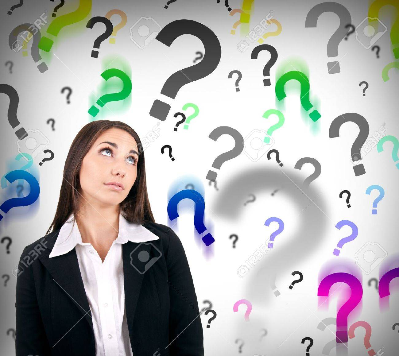 businesswoman with question marks behind her, hard decision - 9653510
