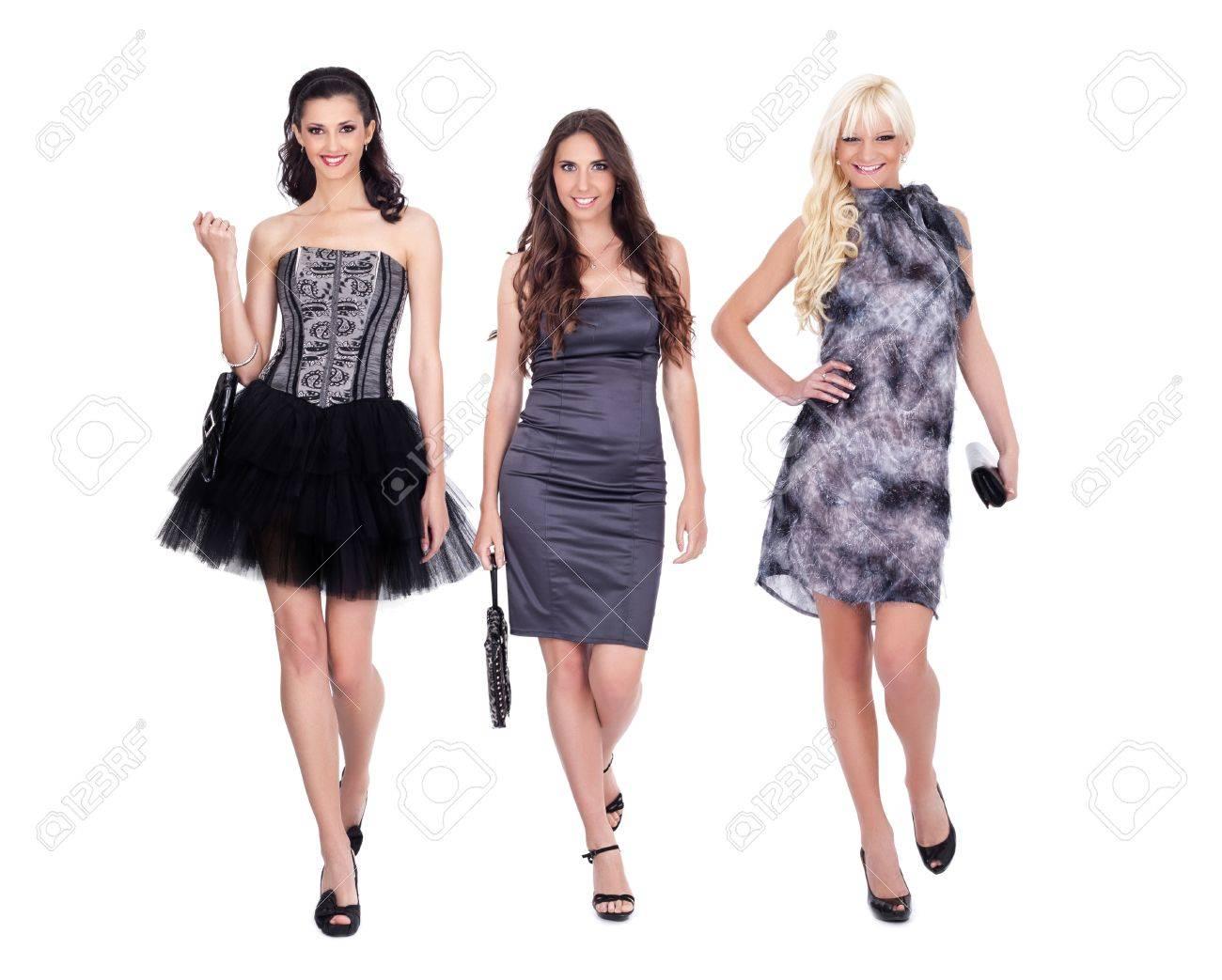 Fashion Girls In Dresses Smiling Walking Towards The Camera ...